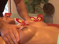 Brunette Nymph Gets Her Starving Twat Serviced ont eh Massage Table