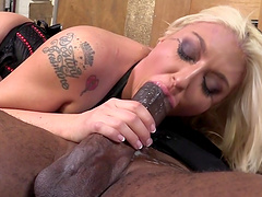 Tattooed cowgirl in high heels banging on a big cock doggystyle