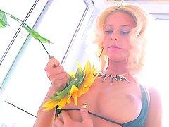 Blonde cutie Maya F drilling her tight butt with a long dildo