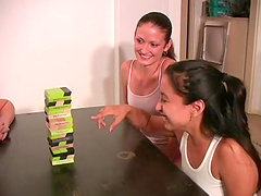 Amateur girls drop their clothes while playing jenga at home