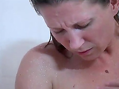 Solo chick Devon Lee moans while masturbating in the shower