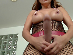 Glamorous solo model in sexy fishnet lingerie masturbating with huge strap on cock