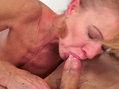 Horny granny Katherin with small tits enjoys riding a younger lover