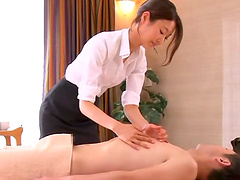 Beautiful Asian babe massaging her dude then gives him an amazing handjob till he cums