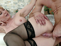 Enticing blonde MILF moaning as she gets screwed doggystyle