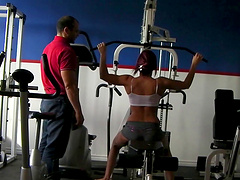 Pretty redhead cowgirl with big tits exercises in the gym