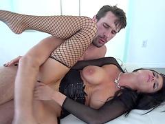 Captivating brunette with long hair giving huge cock handjob