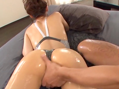 Wanton Asian cowgirl with natural tits getting fingered then slammed missionary style in an oily action