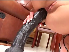 Shady brunette solo model in thongs with natural tits entrancing her pussy with a huge anal toy