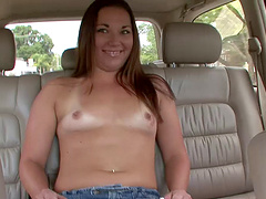 Blazing cowgirl with small tits and shaved pussy masturbating in close up car shoot