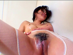 Alluring cowgirl in fishnet lingerie yelling while her hairy pussy is fingered in the bathroom