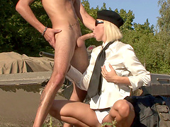 Vivacious blonde in glasses licking balls amazingly before getting hammered doggy style in an outdoor action