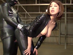 Enchanting Asian with big tit clad in leather getting her pussy drilled with toys a wild threesome BDSM fetish