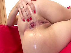 Icy hot solo model with piercing fingering her shaved pussy before drilling her anal with a toy