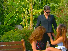 Stunning lesbian in glasses getting her anal fingered in a reality shoot outdoor