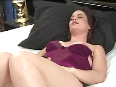 Affectionate mature babes feasting her hairy pussy using huge sex toy on bed