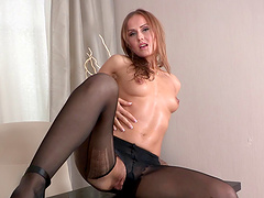 Solo model Sabrina Moor spreads her long legs to masturbate