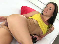 Video of horny brunette Niki Sweet riding a giant fake cock