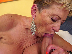 Charming granny with big tits giving her guy stunning blowjob