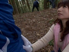 Alluring Asian cowgirl with long hair giving massive dick handjob outdoor