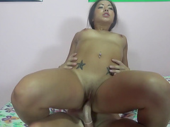Curvy Asian babe giving a handjob before getting her shaved pussy drilled hardcore