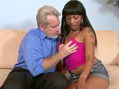 Desirous ebony cowgirl with a shaved pussy gets fucked hardcore by a white stud