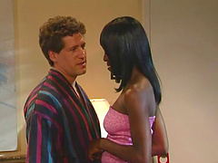 Dashing ebony babe in high heels enjoys getting pounded hardcore in a spicy interracial shoot