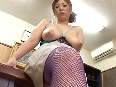 Bubbly Asian milf  with glasses giving an orgasmic handjob