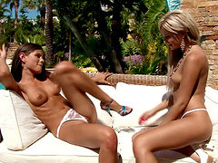 Flirtatious lesbian babes with medium tits enjoying a hot pussy licking session outdoors