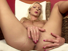 Fantastic blonde babe enjoys masturbating with a dildo close up