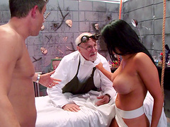Brunette wife with big fake tits fucked by her horny partner