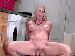 Blonde mature Simona Sonay with big fake tits gets cum in mouth