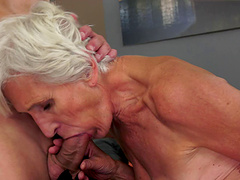 Bleach blonde granny takes an orgasmic ride on a hung stud's cock