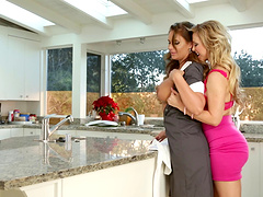 Wavy haired lesbian hottie gets her anal fingered in the kitchen