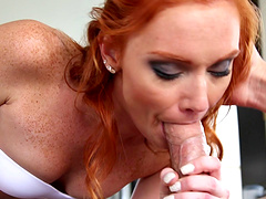 Redhead chic chocks her throat with a huge pecker in a close up shoot