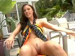 Long haired blonde poses invitingly parading her shaved pussy outdoors