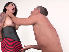 Tattooed brunette makes that satisfied face when a mammoth rod sinks her cooter