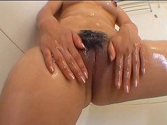 Unshaved and horny Asian mature gets her pussy fingered by a dude