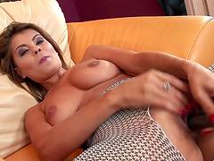 Blissful solo model in fishnet lingerie masturbating with a dildo