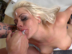Bikini clad blonde with a tattoo forced to swallow cum after a deep pussy drilling