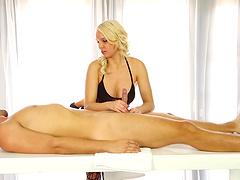 Gorgeous blonde pornstar with big tits giving a sensual handjob