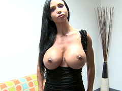 Long haired brunette milf gags on a schlong and gets cum on her big melons