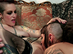 Lesbian stunner has her punk pussy drilled with a strap on dildo