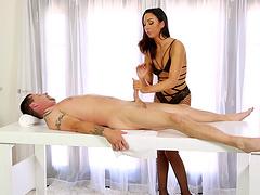 Stunning massage therapist in slutty stockings milking a man's cock