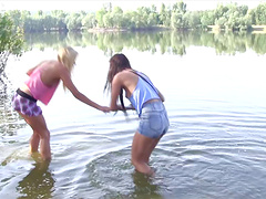 Muff diving teenies kissing and having oral sex outdoors