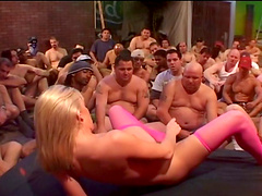 Blonde milf masturbating in front of a crowd before a facial in a close shoot