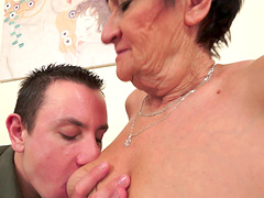 Short-haired brass gives a blowjob and gets bonked with passion