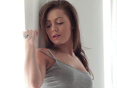 Appealing beauty pulls down her panties and masturbates with passion