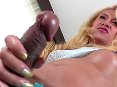 Classy blonde shemale exposes her fascinating black cock
