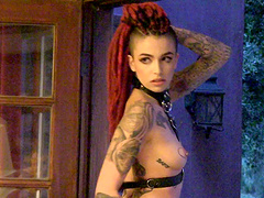 Redhead with a gorgeous tattooed body shows off her curves